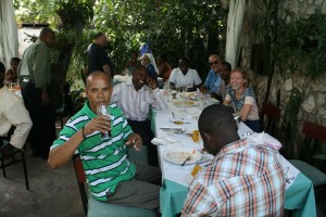 Jean Marie sipping a Coke with Roland and Jean Baptise